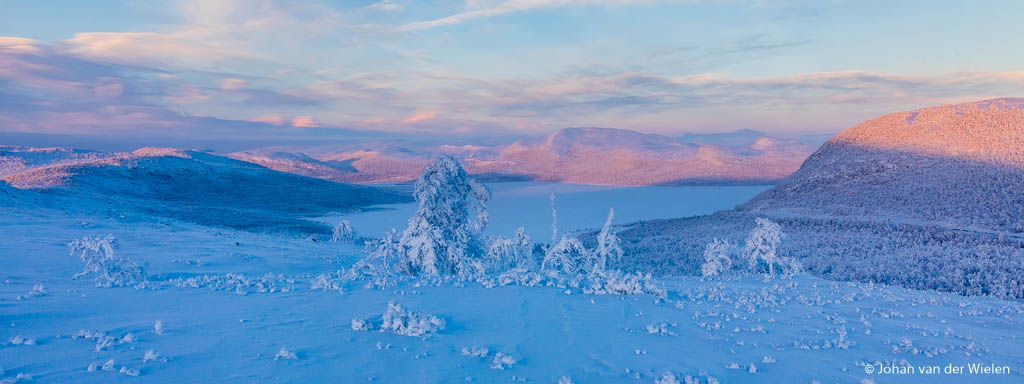 The pink color of the arctic...  Made during the Arctic Aurora Chase 2019 #aac2019  On one very cold morning near Kilpisjärvi, Finland, we climbed with snowshoes on the hill to have look over the border towards Sweden. The sun was rising from behind, shining with its special pink color on the snowy mountains...  regards, Johan van der Wielen